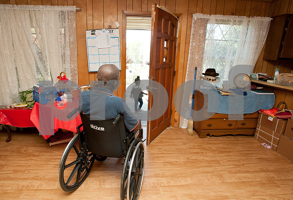 photo by Sarah A. Miller   Pictured April 5, 2013, Ernest Jackson, then 74, watches his great great granddaughter Jazmine McCin, then 2, play outside their front door in Winona.