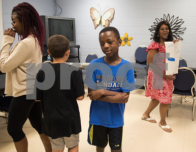 Students walk to the beat as instructor Debbie Broughton teaches them about reading music at Debbie's Music Academy Camp held Wednesday June 21, 2017 at the Glass Recreation Center.   (Sarah A. Miller/Tyler Morning Telegraph)