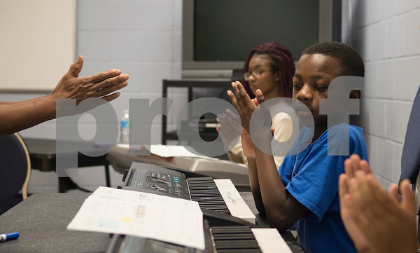 Aaron McCorvey, 10, claps along to the beat of a song at Debbie's Music Academy Camp held Wednesday June 21, 2017 at the Glass Recreation Center.   (Sarah A. Miller/Tyler Morning Telegraph)