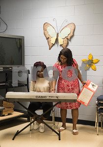 Instructor Debbie Broughton helps Aaliyah Dargan, 15, with her keyboard at Debbie's Music Academy Camp held Wednesday June 21, 2017 at the Glass Recreation Center.   (Sarah A. Miller/Tyler Morning Telegraph)