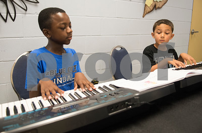 Aaron McCorvey, 10, and Maddox Steward, 8, learn to play keyboard at Debbie's Music Academy Camp held Wednesday June 21, 2017 at the Glass Recreation Center.   (Sarah A. Miller/Tyler Morning Telegraph)