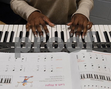 Aaliyah Dargan, 15, plays a keyboard at Debbie's Music Academy Camp held Wednesday June 21, 2017 at the Glass Recreation Center.   (Sarah A. Miller/Tyler Morning Telegraph)