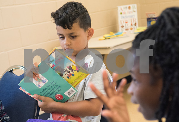 Kadon KB, 7, reads during a Read Across America summer reading program held at the Glass Recreation Center. The program aims to strengthen students' reading skills before they head back to school in the fall.  (Sarah A. Miller/Tyler Morning Telegraph)