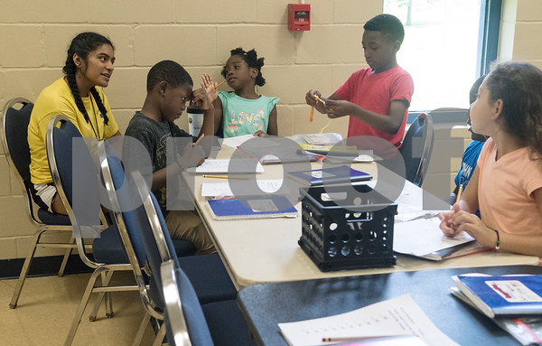 Students practice their writing skills during a Read Across America summer reading program held at the Glass Recreation Center. The program aims to strengthen students' reading skills before they head back to school in the fall.  (Sarah A. Miller/Tyler Morning Telegraph)
