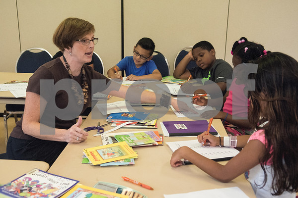 Joanna Neel instructs students as they fill out a rhyming word sheet during a Read Across America summer reading program held at the Glass Recreation Center. The program aims to strengthen students' reading skills before they head back to school in the fall.  (Sarah A. Miller/Tyler Morning Telegraph)