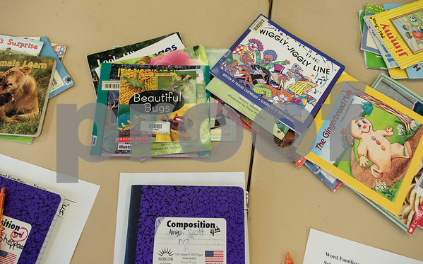 Children's books are set out on a table during a Read Across America summer reading program held at the Glass Recreation Center. The program aims to strengthen students' reading skills before they head back to school in the fall.  (Sarah A. Miller/Tyler Morning Telegraph)