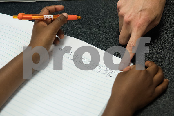 A student practices writing during a Read Across America summer reading program held at the Glass Recreation Center. The program aims to strengthen students' reading skills before they head back to school in the fall.  (Sarah A. Miller/Tyler Morning Telegraph)