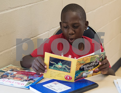 CJ Madison, 8, reads during a Read Across America summer reading program held at the Glass Recreation Center. The program aims to strengthen students' reading skills before they head back to school in the fall.  (Sarah A. Miller/Tyler Morning Telegraph)