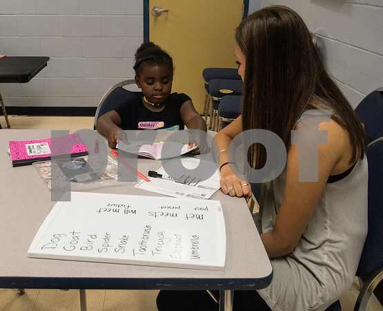 Simone Gunter works with student Laila Johnson, 5, during a Read Across America summer reading program held at the Glass Recreation Center. The program aims to strengthen students' reading skills before they head back to school in the fall.  (Sarah A. Miller/Tyler Morning Telegraph)