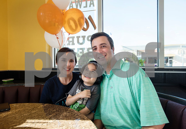 Natalie White, William White, 6, and Jonathan White pose for a photograph at a special party held for William at Whataburger #1107 in Tyler on Tuesday June 26, 2018.   (Sarah A. Miller/Tyler Morning Telegraph)
