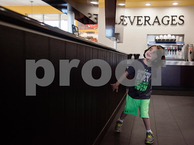 William White, 6, looks around at digital screens on the walls during a special party held for William at Whataburger #1107 in Tyler on Tuesday June 26, 2018. William has autism, and going to Whataburger to eat French fries is part of his daily routine. Besides French fries, William also likes the architecture, windows, neon lights and digital screens inside the restaurant.  (Sarah A. Miller/Tyler Morning Telegraph)