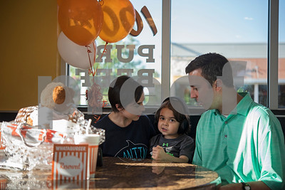 Natalie White and Jonathan White sit with their son William White, 6, during a special party held for William at Whataburger #1107 in Tyler on Tuesday June 26, 2018. William has autism, and going to Whataburger to eat French fries is part of his daily routine. He wore headphones to block out excess noise because he is sensitive to loud sounds.  (Sarah A. Miller/Tyler Morning Telegraph)