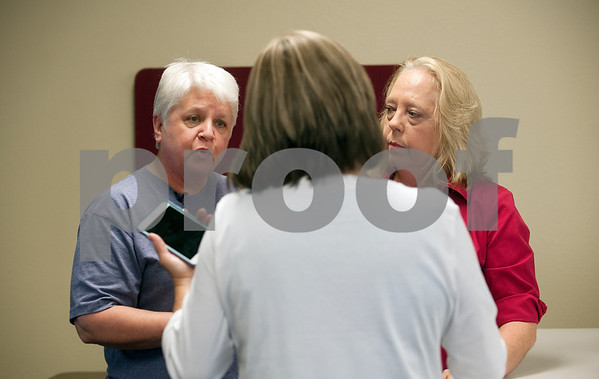 Smith County Clerk, Karen Phillips tells Tyler residents D. Karen Wilkerson and Jolie Smith she cannot not accept their marriage license application Friday in Tyler, Texas. The same sex couple went to file their marriage license after a Friday morning decision by the Supreme Court made gay marriage legal in all 50 states.  (photo by Sarah A. Miller/Tyler Morning Telegraph)