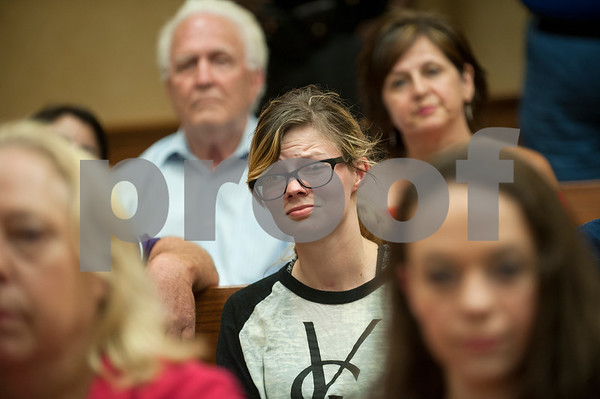 Landice Anderson, center, listens as Smith County Clerk Karen Phillips states during a press conference that the county will not yet legalize gay marriage.   (photo by Sarah A. Miller/Tyler Morning Telegraph)