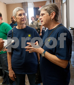 Lou Anne Smoot of Tyler, left, and her partner Brenda McWilliams of Tyler, right, talk to the media after a press conference with Smith County Clerk Karen Phillips about same sex marriage licenses. The couple came to support Tyler residents Jolie Smith and D. Karen Wilkerson who tried to submit their license for marriage at the Smith County Courthouse Annex building Friday morning but were denied by Phillips.  (photo by Sarah A. Miller/Tyler Morning Telegraph)