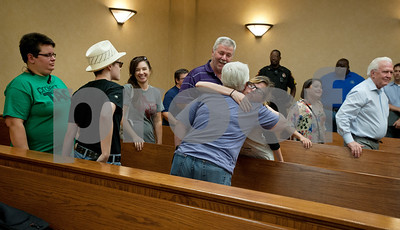 Landice Anderson, right, gives D. Karen Wilkerson a hug after a press conference by Smith County Clerk Karen Phillips states that the county will not yet legalize gay marriage. Wilkerson and her partner tried to file their marriage license this morning at the at the Smith County Courthouse Annex building but were denied by Phillips.  (photo by Sarah A. Miller/Tyler Morning Telegraph)