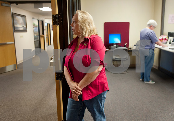 Tyler resident Jolie Smith looks out into the hallway as her partner D. Karen Wilkerson calls to file a complaint with the American Civil Liberties Union at the Smith County Courthouse Annex building Friday morning as they try to file a marriage license. Smith County Clerk Karen Phillips told the couple that she cannot not accept their marriage license. The same sex couple went to file their marriage license after a Friday morning decision by the Supreme Court made gay marriage legal in all 50 states.  (photo by Sarah A. Miller/Tyler Morning Telegraph)