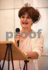 LaurieAnn Frank speaks about her relative Thomas Elam Swann during the Half Mile of History marker unveiling at Gallery Main Street in Tyler Tuesday June 28, 2016. Swann was a philanthropist and businessman who opened Swann Furniture Company.   (Sarah A. Miller/Tyler Morning Telegraph)