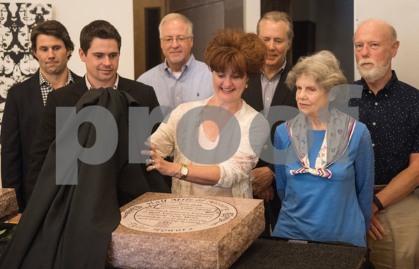 LaurieAnn Frank is surrounded by family as she pulls the cover off the Half Mile of History marker for her relative Thomas Elam Swann at Gallery Main Street in Tyler Tuesday June 28, 2016. Swann was a philanthropist and businessman who opened Swann Furniture Company.   (Sarah A. Miller/Tyler Morning Telegraph)