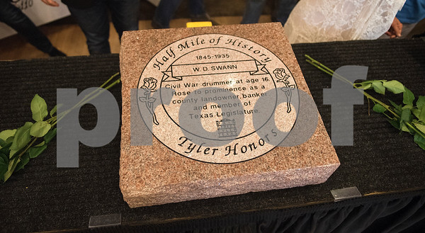 W.D. Swann is honored with a marker during the Half Mile of History marker unveiling at Gallery Main Street in Tyler Tuesday June 28, 2016. Swann was in the Douglas Battery and a director of Citizens National Bank.  (Sarah A. Miller/Tyler Morning Telegraph)