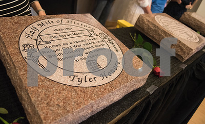 Col. Bryan Marsh is honored with a marker during the Half Mile of History marker unveiling at Gallery Main Street in Tyler Tuesday June 28, 2016. Marsh was a captain in the Texas Calvary during the Civil War and also served as a Texas Ranger and sheriff of Smith County.   (Sarah A. Miller/Tyler Morning Telegraph)