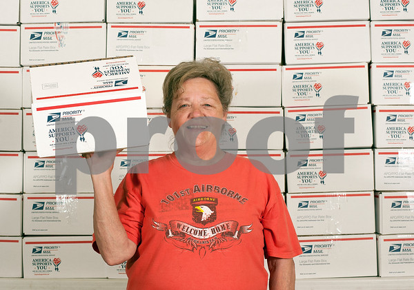 photo by Sarah A. Miller/Tyler Morning Telegraph  Polly Morman of Tyler stands in front of some of the over 50 care package boxes she and her small group of volunteers put together Monday June 10 for American military men and women serving overseas. The Adopt-A-Box program headed by Morman meets several times a year to gather donations and put together care packages of snack foods and hygiene items for soldiers.