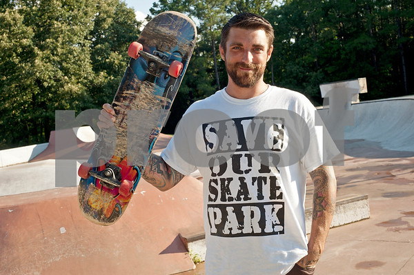 photo by Sarah A. Miller  Mike Minter, 34, sells Save Our Skatepark teeshirts to raise money for renovations to Tyler's Noble E. Young Skatepark.
