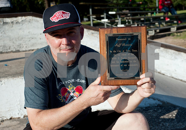 photo by Sarah A. Miller  Jeff Reeves, 51, holds a plaque he received in 1998 for his vision to create Noble E. Young Skatepark.