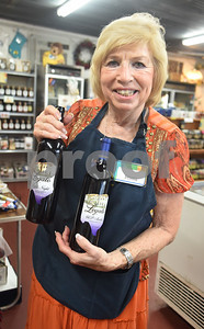 Owner Phyllis Vaselenuick holds two bottles of wine made from blackberries and blueberries from Echo Springs Blueberry Farm in Brownsboro Friday June 24, 2016.   (Sarah A. Miller/Tyler Morning Telegraph)