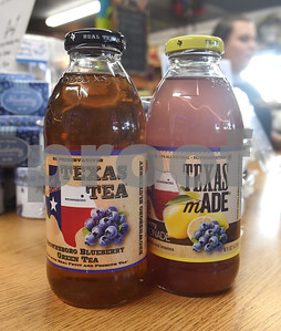 A jar of blueberry green tea and blueberry lemonade made with blueberries from Echo Springs Blueberry Farm in Brownsboro sit on the counter of the store on the farm's property Friday June 24, 2016.   (Sarah A. Miller/Tyler Morning Telegraph)