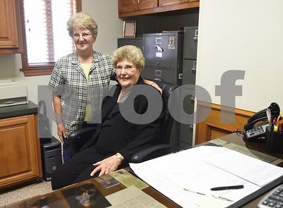 Certified Roses, Inc. administrative assistant Paulette Boswell is pictured with president Shirley Staples at their office in Tyler June 24, 2016. Staples is retiring after 56 years with the company. Boswell has been employed for 45 years.  (Sarah A. Miller/Tyler Morning Telegraph)