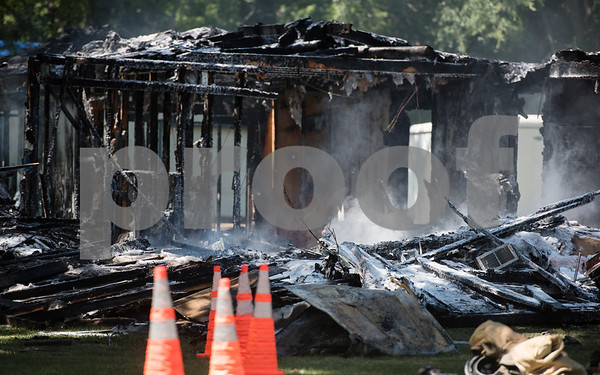 A house caught fire in the 16,000 block of Big Oak Bay Road in New Chapel Hill. No one was injured in the fire.  (Sarah A. Miller/Tyler Morning Telegraph)