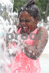 Katelyn Swindle, 8, plays in the splash pad area during the opening day of Fun Forest pool, 900 N. Glenwood Blvd. Saturday June 4, 2016. This free city pool will be open from June 4 to Aug. 13 Tuesdays through Thursdays from 1 to 6 p.m. and Fridays and Saturday from 1 to 7 p.m. for open swim. Lap swim is available on Tuesdays and Thursdays from 6 to 8 p.m. The City of Tyler Parks and Recreation Department is still looking for qualified lifeguards to work at both Fun Forest and Woldert pools.  (Sarah A. Miller/Tyler Morning Telegraph)