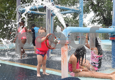 Kayleigh Fisher, 2, plays in the splash pad area during the opening day of Fun Forest pool, 900 N. Glenwood Blvd. Saturday June 4, 2016. This free city pool will be open from June 4 to Aug. 13 Tuesdays through Thursdays from 1 to 6 p.m. and Fridays and Saturday from 1 to 7 p.m. for open swim. Lap swim is available on Tuesdays and Thursdays from 6 to 8 p.m. The City of Tyler Parks and Recreation Department is still looking for qualified lifeguards to work at both Fun Forest and Woldert pools.  (Sarah A. Miller/Tyler Morning Telegraph)