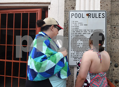 Brenda Choy and her daughter Piper Choy, 12, read the rules before entering Fun Forest pool, 900 N. Glenwood Blvd., which opened Saturday June 4, 2016. This free city pool will be open from June 4 to Aug. 13 Tuesdays through Thursdays from 1 to 6 p.m. and Fridays and Saturday from 1 to 7 p.m. for open swim. Lap swim is available on Tuesdays and Thursdays from 6 to 8 p.m. The City of Tyler Parks and Recreation Department is still looking for qualified lifeguards to work at both Fun Forest and Woldert pools.  (Sarah A. Miller/Tyler Morning Telegraph)