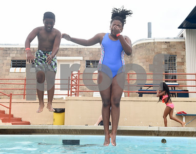 Nicolas Stephens-McGowan, 10, and Victoria Grant, 10, jump into the water during the opening day of Fun Forest pool, 900 N. Glenwood Blvd. Saturday June 4, 2016. This free city pool will be open from June 4 to Aug. 13 Tuesdays through Thursdays from 1 to 6 p.m. and Fridays and Saturday from 1 to 7 p.m. for open swim. Lap swim is available on Tuesdays and Thursdays from 6 to 8 p.m. The City of Tyler Parks and Recreation Department is still looking for qualified lifeguards to work at both Fun Forest and Woldert pools.  (Sarah A. Miller/Tyler Morning Telegraph)