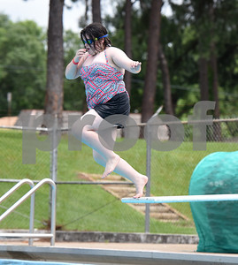 Piper Choy, 12, jumps off the diving board at Fun Forest pool, 900 N. Glenwood Blvd., which opened Saturday June 4, 2016. This free city pool will be open from June 4 to Aug. 13 Tuesdays through Thursdays from 1 to 6 p.m. and Fridays and Saturday from 1 to 7 p.m. for open swim. Lap swim is available on Tuesdays and Thursdays from 6 to 8 p.m. The City of Tyler Parks and Recreation Department is still looking for qualified lifeguards to work at both Fun Forest and Woldert pools.  (Sarah A. Miller/Tyler Morning Telegraph)
