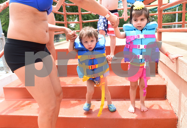 Janice Robison of Tyler walks her children Jonah, 1, and Joleah, 3, down the stairs to the pool during the opening day of Fun Forest pool, 900 N. Glenwood Blvd. Saturday June 4, 2016. This free city pool will be open from June 4 to Aug. 13 Tuesdays through Thursdays from 1 to 6 p.m. and Fridays and Saturday from 1 to 7 p.m. for open swim. Lap swim is available on Tuesdays and Thursdays from 6 to 8 p.m. The City of Tyler Parks and Recreation Department is still looking for qualified lifeguards to work at both Fun Forest and Woldert pools.  (Sarah A. Miller/Tyler Morning Telegraph)