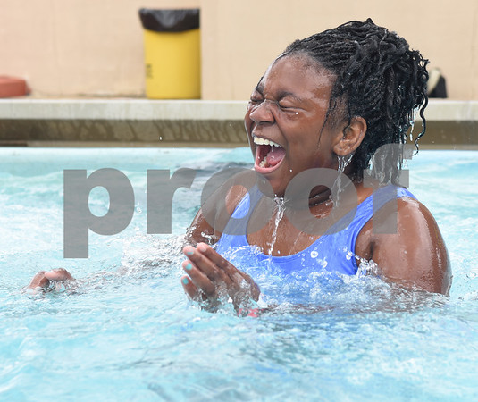 Victoria Grant, 10, reacts after jumping into the water during the opening day of Fun Forest pool, 900 N. Glenwood Blvd. Saturday June 4, 2016. This free city pool will be open from June 4 to Aug. 13 Tuesdays through Thursdays from 1 to 6 p.m. and Fridays and Saturday from 1 to 7 p.m. for open swim. Lap swim is available on Tuesdays and Thursdays from 6 to 8 p.m. The City of Tyler Parks and Recreation Department is still looking for qualified lifeguards to work at both Fun Forest and Woldert pools.  (Sarah A. Miller/Tyler Morning Telegraph)