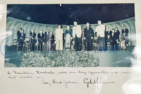 Franklin Kimlicko with others with Lady Bird Johnson and Lyndon B. Johnson in a picture signed by the former first lady and president. (Photo courtesy of Franklin Kimlicko)