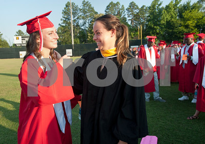 Robert E. Lee High School softball coach Maggie Stephenson congratulates senior team pitcher Makenna Aycock before the graduation ceremony Friday night at Trinity Mother Frances Rose Stadium. Aycock received a full scholarship to Hill College for softball.  (photo by Sarah A. Miller/Tyler Morning Telegraph)