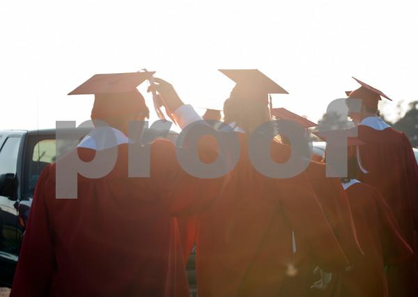 Robert E. Lee High School seniors walk to their graduation ceremony Friday night at Trinity Mother Frances Rose Stadium.   (photo by Sarah A. Miller/Tyler Morning Telegraph)