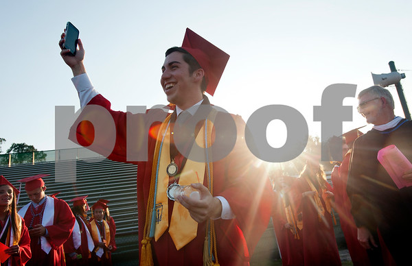 Robert E. Lee High School senior Ethan Elkins takes a selfie as he waits for his graduation to begin Friday night at Trinity Mother Frances Rose Stadium.   (photo by Sarah A. Miller/Tyler Morning Telegraph)