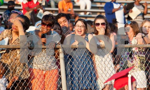 Family members cheer on the senior as they enter the stadium for the Robert E. Lee High School graduation Friday night.  (photo by Sarah A. Miller/Tyler Morning Telegraph)
