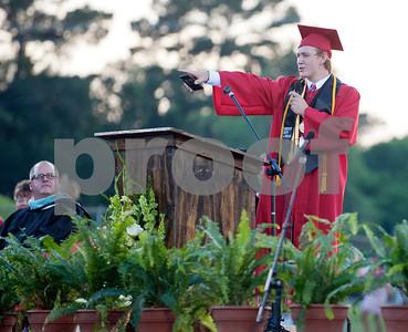 Robert E. Lee High School Salutatorian Trevor Carr sings at the end of his speech graduation Friday night.  (photo by Sarah A. Miller/Tyler Morning Telegraph)