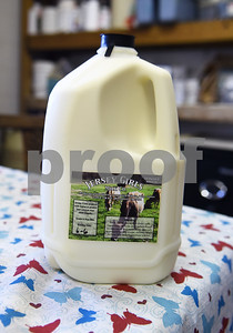Raw milk is sold by the gallon inside the store at Jersey Girls Milk Company in Winnsboro Tuesday June 7, 2016.  (Sarah A. Miller/Tyler Morning Telegraph)