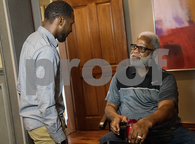 Emmanuel Daniels, John Tyler High School's 2018 Valedictorian, greets Earl Campbell as he arrives at Willow Brook Country Club on Thursday June 7, 2018. Daniels received the fourth annual Earl Campbell Tyler Rose Academic Scholarship Award during a luncheon at Willow Brook Country Club.  (Sarah A. Miller/Tyler Morning Telegraph)