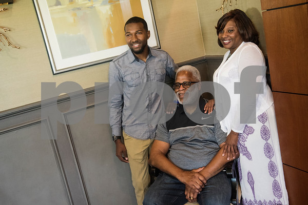 Earl Campbell, center, meets with Emmanuel Daniels, John Tyler High School's 2018 Valedictorian, and Daniels' mother Mary Foreman, before a luncheon at Willow Brook Country Club on Thursday June 7, 2018. Daniels received the fourth annual Earl Campbell Tyler Rose Academic Scholarship Award.  (Sarah A. Miller/Tyler Morning Telegraph)