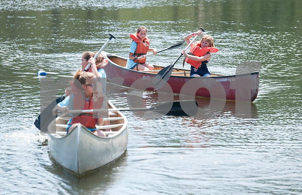 Lucy Bailey, 9, of Winona and Lexi Marsh, 11, of Winona, paddle a canoe at Girls in Action camp at Timberline Camp in Lindale Thursday June 9, 2016. Girls in Action and is a missions discipleship organization for girls in first through sixth grades.  (Sarah A. Miller/Tyler Morning Telegraph)