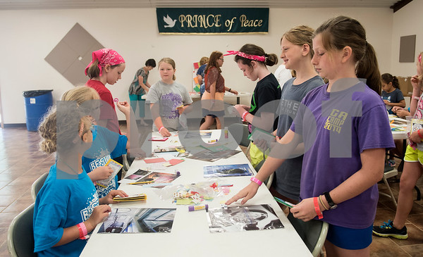 Girls make journals during craft time at Girls in Action camp at Timberline Camp in Lindale Thursday June 9, 2016. Girls in Action and is a missions discipleship organization for girls in first through sixth grades.  (Sarah A. Miller/Tyler Morning Telegraph)